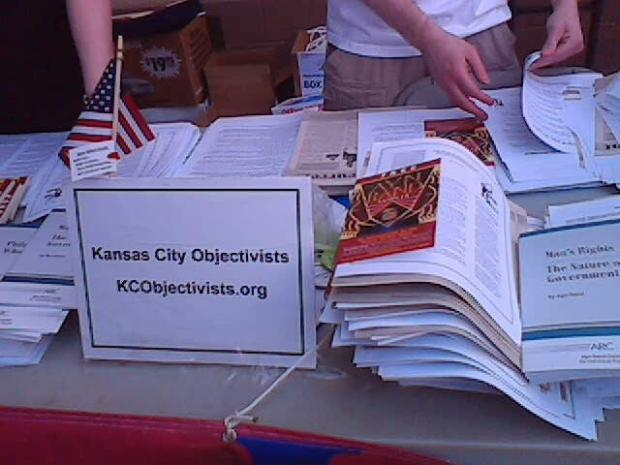 Kansas City Objectivists. They were giving out literature on Ayn Rand and Objectivism. Yes, I made a joke about them giving it away for free. They had heard hundreds of such jokes already. But really, they were asking for it.